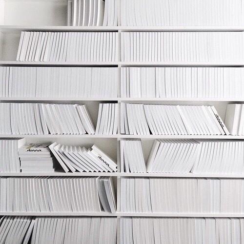 white books on shelf