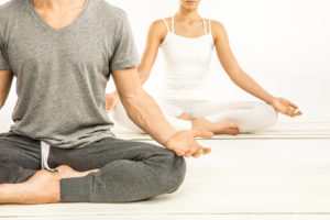 man and woman meditate