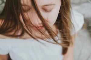 woman meditate eyes closed